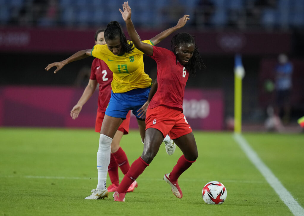 Canada's Deanne Rose, right, and Brazil's Bruna Benites (13) battle for the ball during a women's quarterfinal soccer match at the 2020 Summer Olympics, Friday, July 30, 2021, in Rifu, Japan.