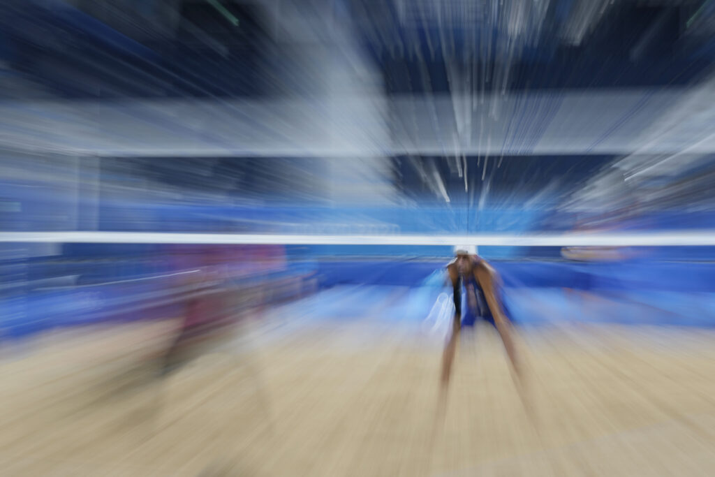 Jake Gibb, of the United States, competes during a men's beach volleyball match against Qatar at the 2020 Summer Olympics, Friday, July 30, 2021, in Tokyo, Japan.