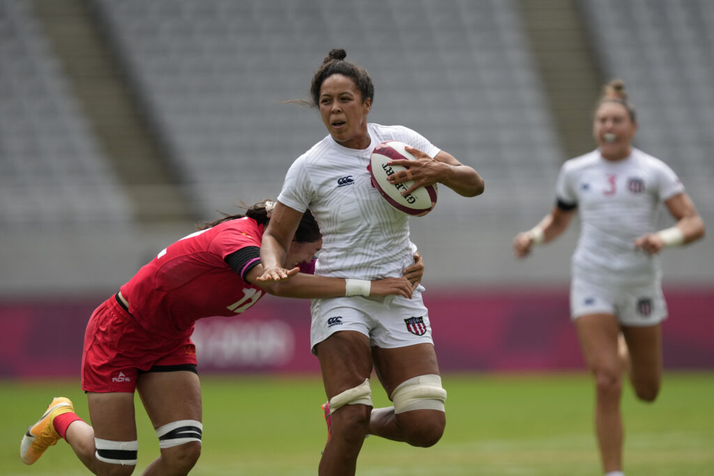 Jordan Matyas of the United States, center, is tackled by China's Ruan Hongting in their women's rugby sevens 5-8 placing match at the 2020 Summer Olympics, Saturday, July 31, 2021 in Tokyo, Japan.