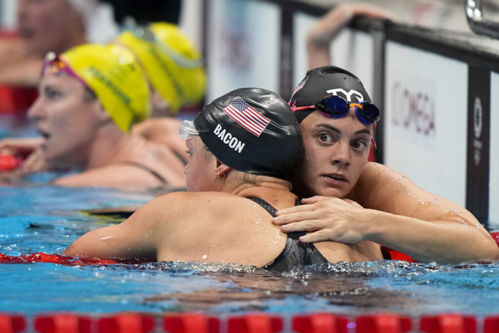Rhyan White, of United States, embraces teammate Phoebe Bacon after the women's 200-meter backstroke final at the 2020 Summer Olympics, Saturday, July 31, 2021, in Tokyo, Japan.