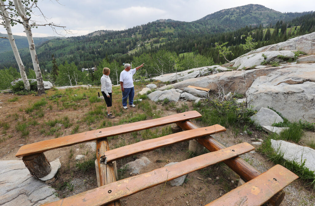 Lisa Adams, chairman of the centennial committee, and maintenance specialist Mike Coulam look over Brighton Girls Camp in Big Cottonwood Canyon on Tuesday, July 13, 2021. This summer marks the 100th anniversary of what is believed to be the oldest camp owned and operated by The Church of Jesus Christ of Latter-day Saints.