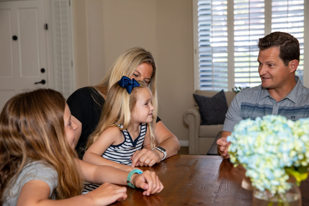 Jeff Daly, right, and his wife, Kendyl Daly, middle, ask their youngest daughter for her opinion during a family council in their Laguna Niguel, California, home on July 18, 2021.