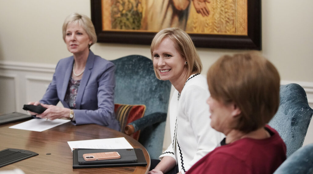 Sister Amy A. Wright, middle, second counselor in the Primary general president; Relief Society General President Jean B. Bingham, left; and Sister Sharon Eubank, first counselor in the Relief Society general presidency, right, talk during a meeting with all nine general women officers, at the Relief Society Building in Salt Lake City on Tuesday, May 18, 2021.