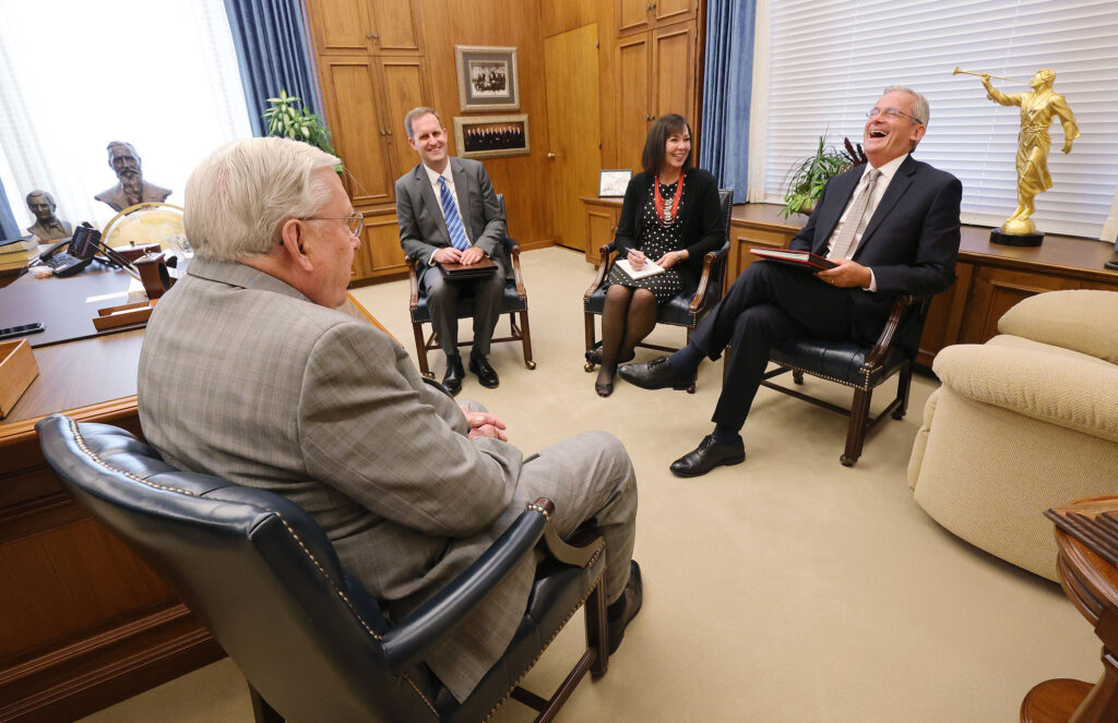 President M. Russell Ballard, Acting President of the Quorum of the Twelve Apostles, shares a laugh with Aaron Jenne, Suzanne Drysdale and Elder Patrick Kearon during a meeting at the Church Administration Building in Salt Lake City on Wednesday, May 12, 2021.