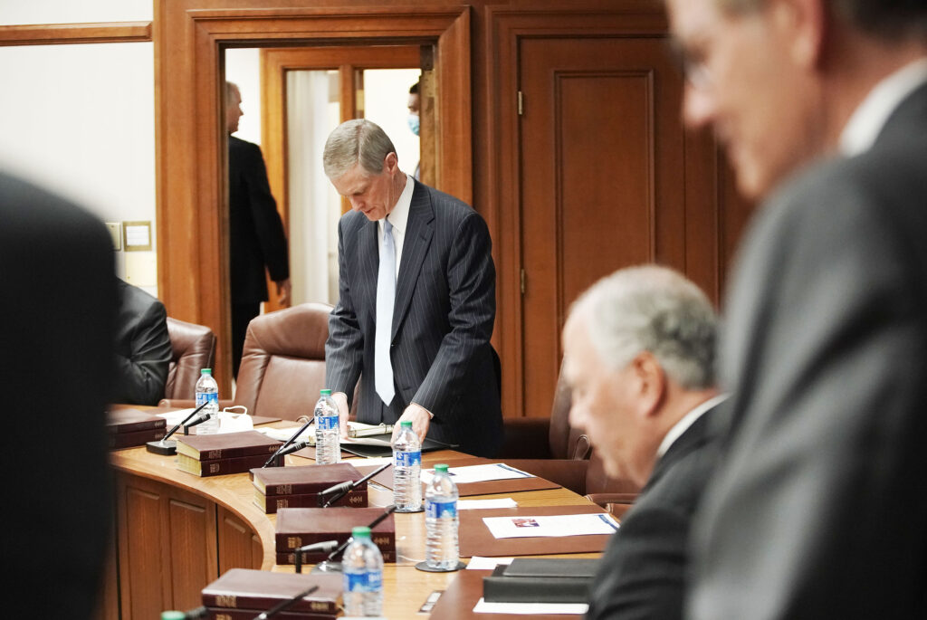 Elder David A. Bednar looks over items on the agenda as the Quorum of the Twelve Apostles gather for their weekly meeting at the Church Administration Building in Salt Lake City on Tuesday, May 11, 2021.