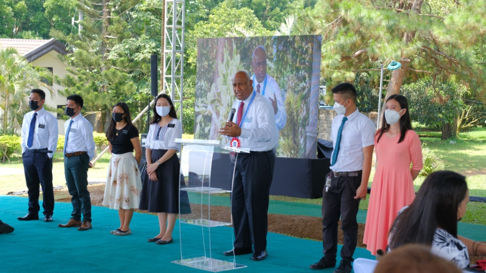 Elder Taniela B. Wakolo, Philippines Area president, with missionaries from the Philippines Antipolo Mission and Joseph and Sarah Jane Vicente at the groundbreaking of the For the Strength of Youth camp on June 30, 2021.