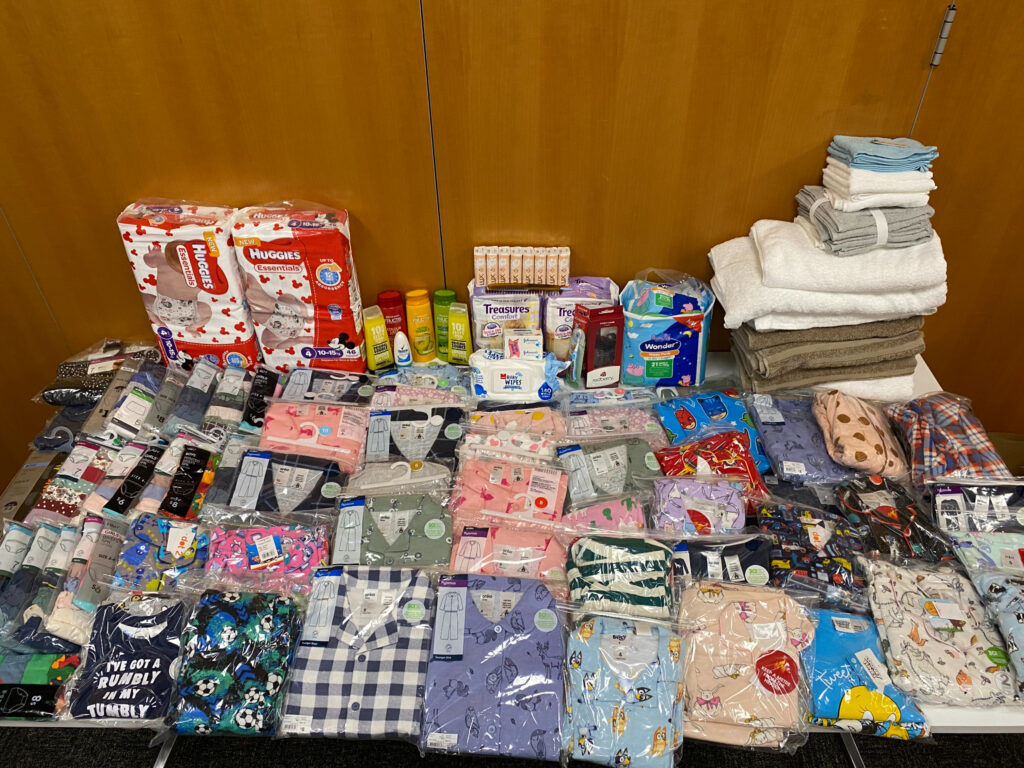 Children's pajamas, underwear, diapers and personal care items donated by Pacific Area Office employees and missionaries are assembled for hand over to Foster Hope in Auckland.
