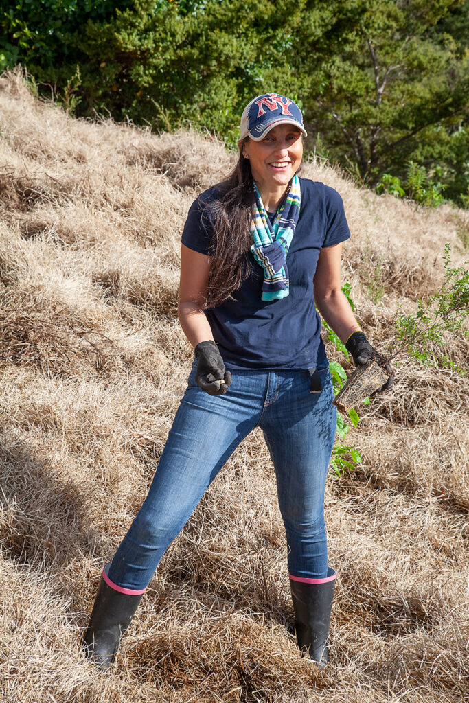 Julia Manuel was among volunteers from the Pacific Area office who planted native shrubs at Wenderholm Regional Park.