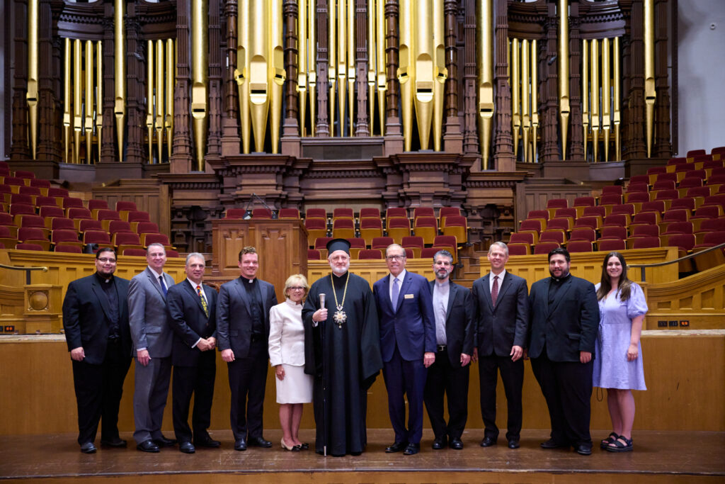 His Eminence Archbishop Elpidophoros of the Greek Orthodox Archdiocese of America, middle, stands with several others inside the Tabernacle on Temple Square on July 22, 2021.