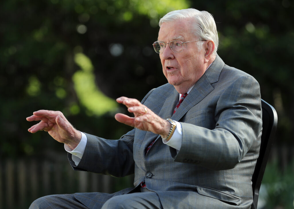President M. Russell Ballard, acting president of the Quorum of the Twelve Apostles of The Church of Jesus Christ of Latter-day Saints, talks about pioneers while sitting in front of the Mary Fielding Smith home at This Is the Place Heritage Park in Salt Lake City on Monday, June 15, 2020.