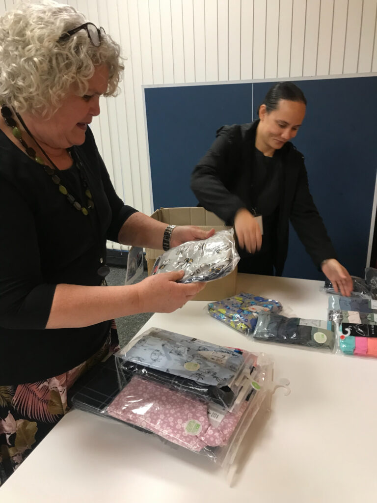 Yvonne Rameka and Maria Talamaivao from the Pacific Area Office load packages of new pajamas and underclothes headed for donation to Foster Hope in Auckland, New Zealand.