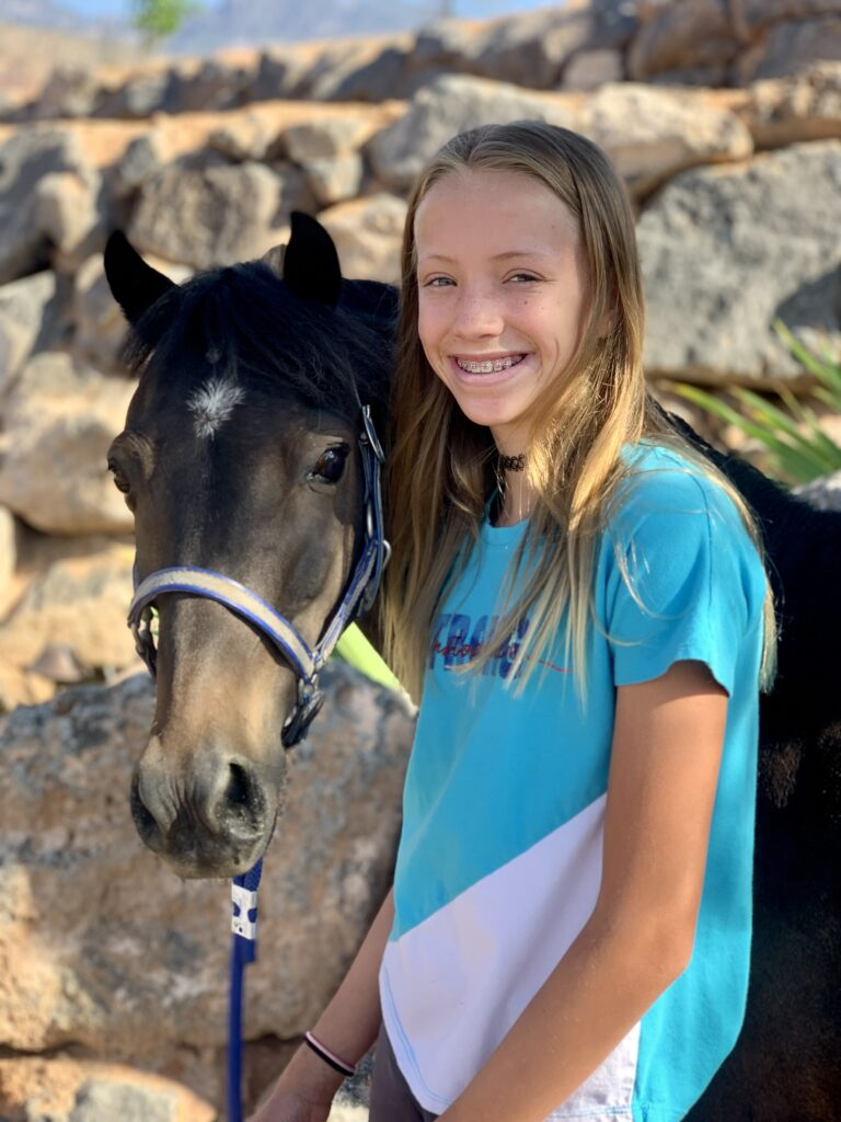 Kyla Law, 13, is pictured with Flash, her Hackney pony. She's been training with Flash since she was 9 years old.