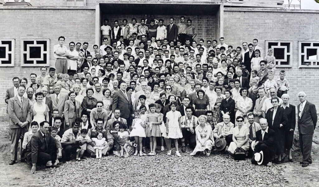 Labor missionaries at the cornerstone laying for the Hamilton New Zealand Temple, December 1956. Elder Hugh B. Brown, who was then an assistant to the Quorum of the Twelve Apostles, presided.