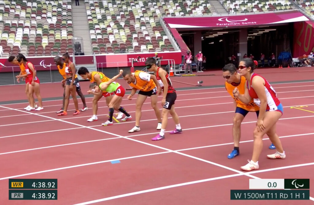 Margarita Faundez of Chile and guide Francisco Segovia, right, line up prior to competing in the women's 1,500-meter T11 round 1 heat 1 at the Tokyo 2020 Paralympic Games in Tokyo Sunday, Aug. 29, 2021.