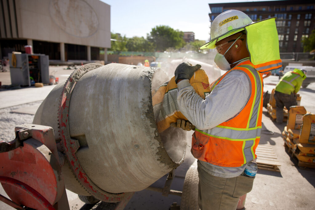 A special mixture of concrete is used to patch damaged sections of concrete on the Church Office Building Plaza, June 2021.
