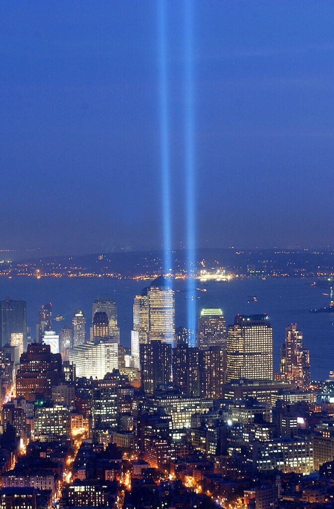"""Twin beams of light form the """"Tribute in Light"""" at the World Trade Center site on the second anniversary of the Sept. 11 attacks Thursday, Sept. 11, 2003 in New York. The photograph was made from the Empire State Building. (AP Photo/Ed Bailey)"""