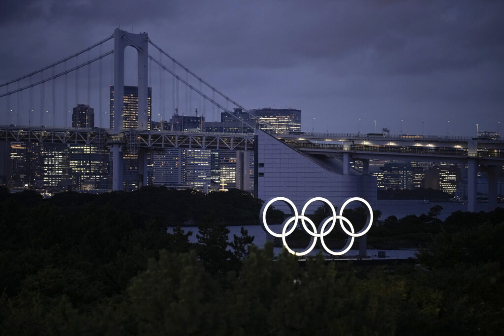 The Olympic rings are illuminated at dusk during the 2020 Summer Olympics, Thursday, July 29, 2021, in Tokyo, Japan.