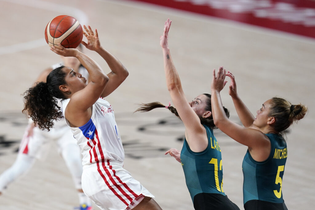 Puerto Rico's Jennifer O'Neill shoots over Australia's Tess Lavey (12) and Leilani Mitchell (5) during a women's basketball preliminary round game at the 2020 Summer Olympics, Monday, Aug. 2, 2021, in Saitama, Japan.
