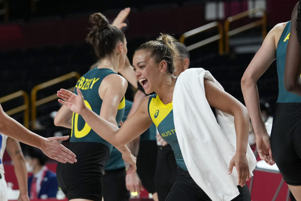 Australia's Leilani Mitchell celebrates with teammates during a women's basketball game against Puerto Rico at the 2020 Summer Olympics, Monday, Aug. 2, 2021, in Saitama, Japan.