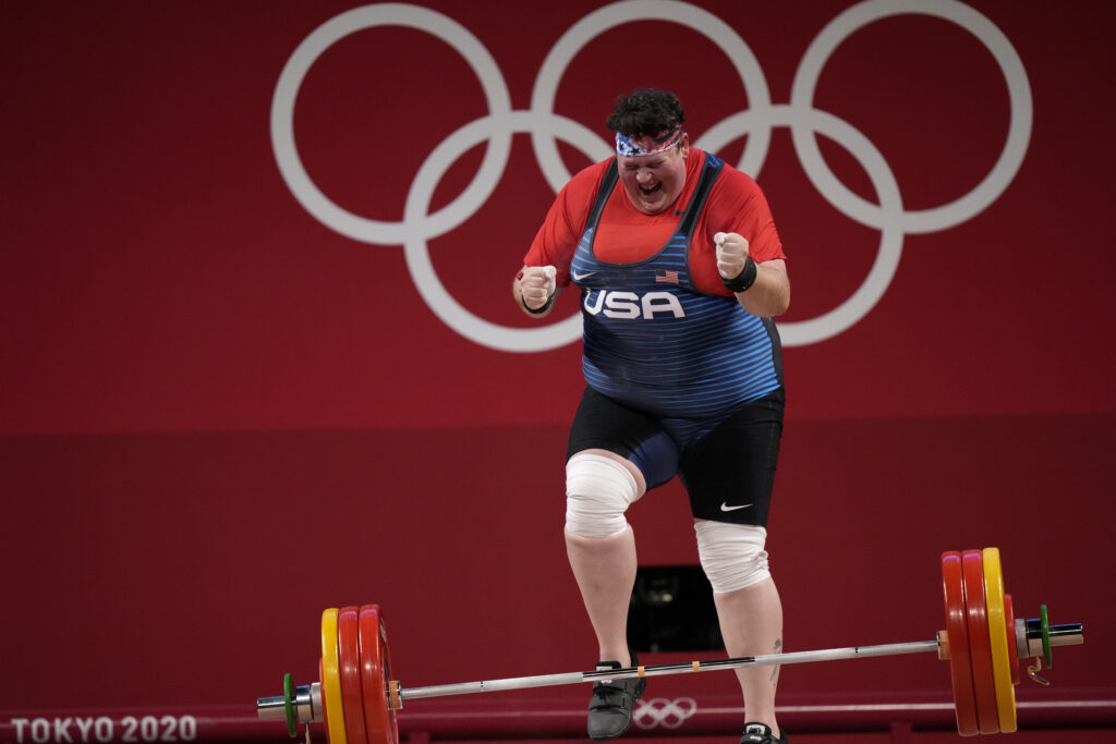 Sarah Elizabeth Robles of the United States celebrates after completing a lift, in the women's over-87-kilogram weightlifting event at the 2020 Summer Olympics, Monday, Aug. 2, 2021, in Tokyo, Japan.