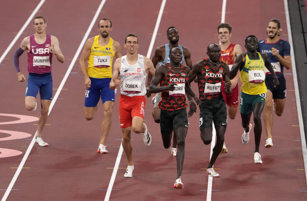 Emmanuel Korir, of Kenya, races to win the gold medal ahead of Ferguson Rotich, of Kenya, silver, and Patryk Dobek, of Poland, bronze, and Peter Bol, of Australia, in the final of the men's 800-meter at the 2020 Summer Olympics, Wednesday, Aug. 4, 2021, in Tokyo, Japan. At second left is Amel Tuka, of Bosnia and Herzegovina.