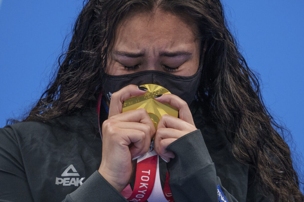 Tupou Neiufi of New Zealand holds her gold medal at the medal ceremony for the women's 100-meter backstroke S8 final, swimming at the Tokyo 2020 Paralympic Games in Tokyo Friday, Aug. 27, 2021.