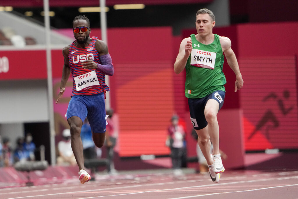 United States' Isaac Jean-Paul, left, and Ireland's Jason Smyth compete in their heat of the T13 men's 100 meters during the 2020 Paralympics at the National Stadium in Tokyo, Sunday, Aug. 29, 2021.