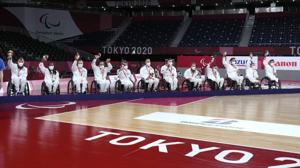 U.S. players celebrate with their silver medals during the awarding ceremony of wheelchair rugby at the Tokyo 2020 Paralympic Games, Sunday, Aug. 29, 2021, in Tokyo, Japan.