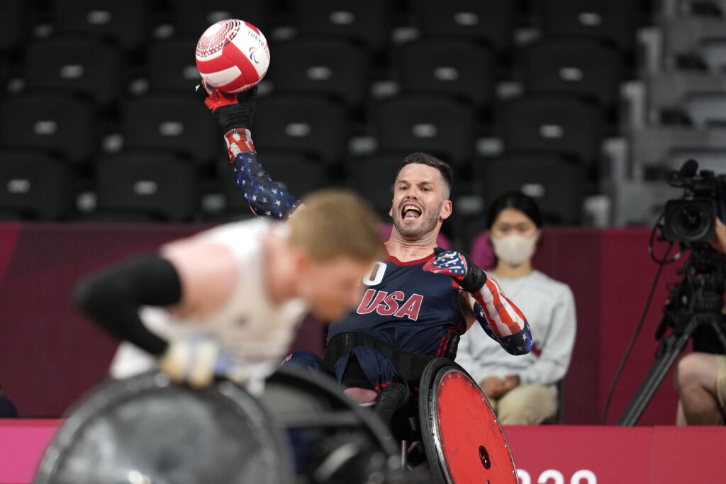 Josh Wheeler of the United States passes the ball during the wheelchair rugby gold-medal match against Britain at the Tokyo 2020 Paralympic Games, Sunday, Aug. 29, 2021, in Tokyo, Japan.