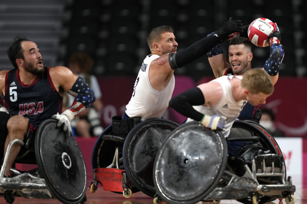 Josh Wheeler of the United States, right, is blocked by Britain's Stuart Robinson during the wheelchair rugby gold-medal match at the Tokyo 2020 Paralympic Games, Sunday, Aug. 29, 2021, in Tokyo, Japan.