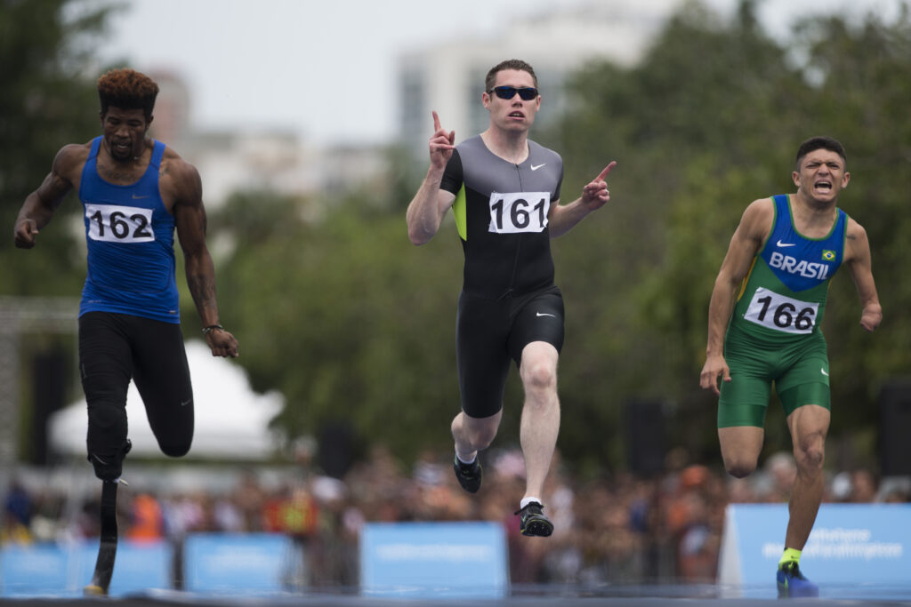 Ireland's Paralympian Jason Smyth, center, celebrates his victory ahead of United States' Richard Browne, left, and Brazil's Petrucio Ferreira, during an event celebrating one year from the start of the Rio 2016 Paralympic Games in Rio de Janeiro, Brazil, Monday, Sept. 7, 2015.