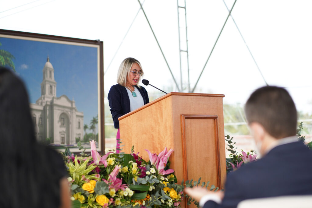 Sister Elaine Parrella speaks to invited guests during the Salvador Brazil Temple groundbreaking service in Salvador, Brazil, on Saturday, Aug. 7, 2021.