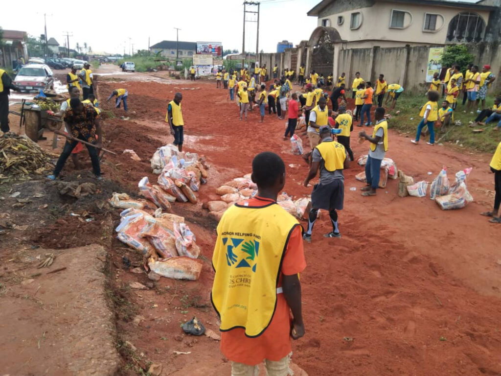 Sandbags and laterite being used to fix dilapidated portions of Adolor Road, Benin-City, Nigeria, by volunteers during the 2021 All Africa Service Day activities of The Church of Jesus Christ of Latter-day Saints on Aug. 21, 2021