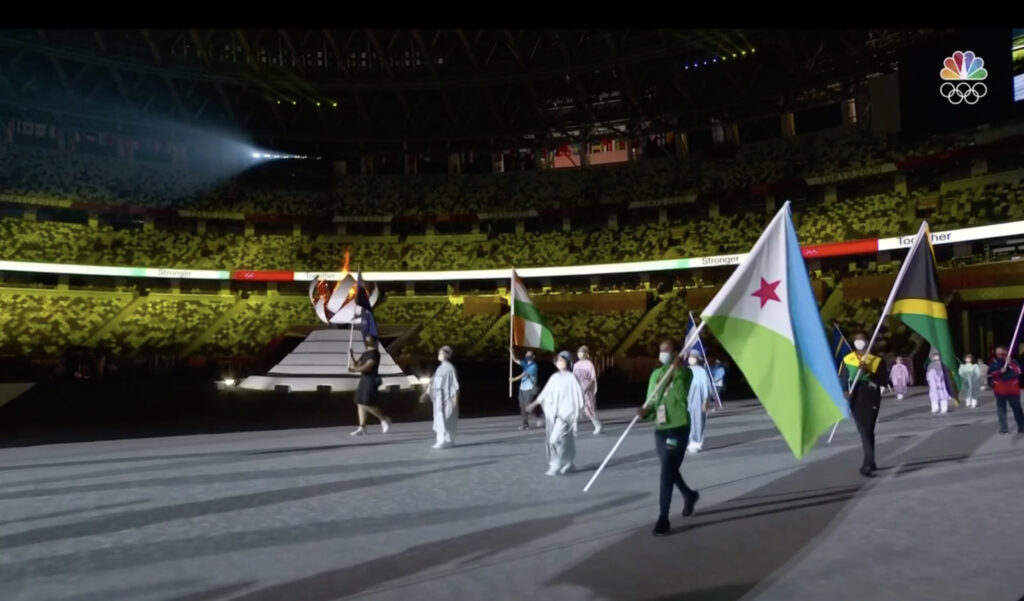 Valeries Adams, left, carries the New Zealand flag past the Olympic flame during the closing ceremony in the Olympic Stadium at the 2020 Summer Olympics, Sunday, Aug. 8, 2021, in Tokyo, Japan.