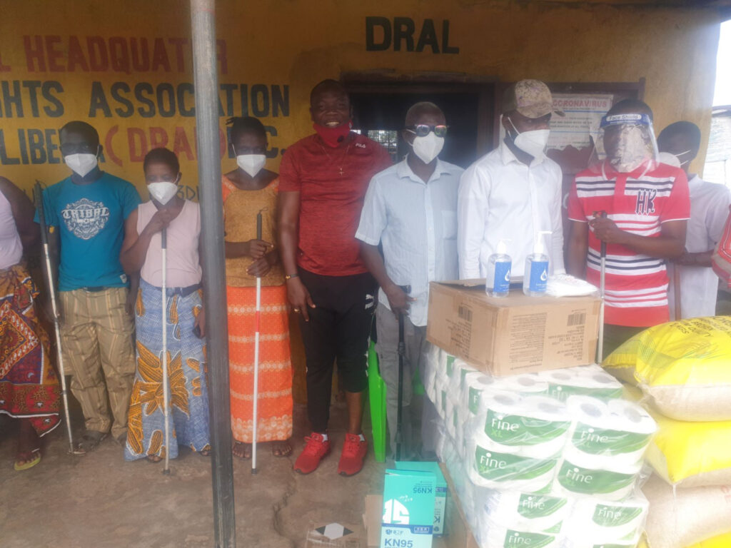 Disabled Rights Association of Liberia receives COVID-19 protection materials and other items from members of The Church of Jesus Christ of Latter-day Saints during activities of the 2021 All Africa Service Day on Aug. 21, 2021.