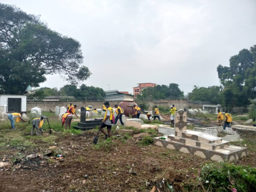 Volunteers help to keep the Osu Royal Cemetery, Accra, Ghana, clean as part of the 2021 All Africa Service Day project on Aug. 21, 2021.