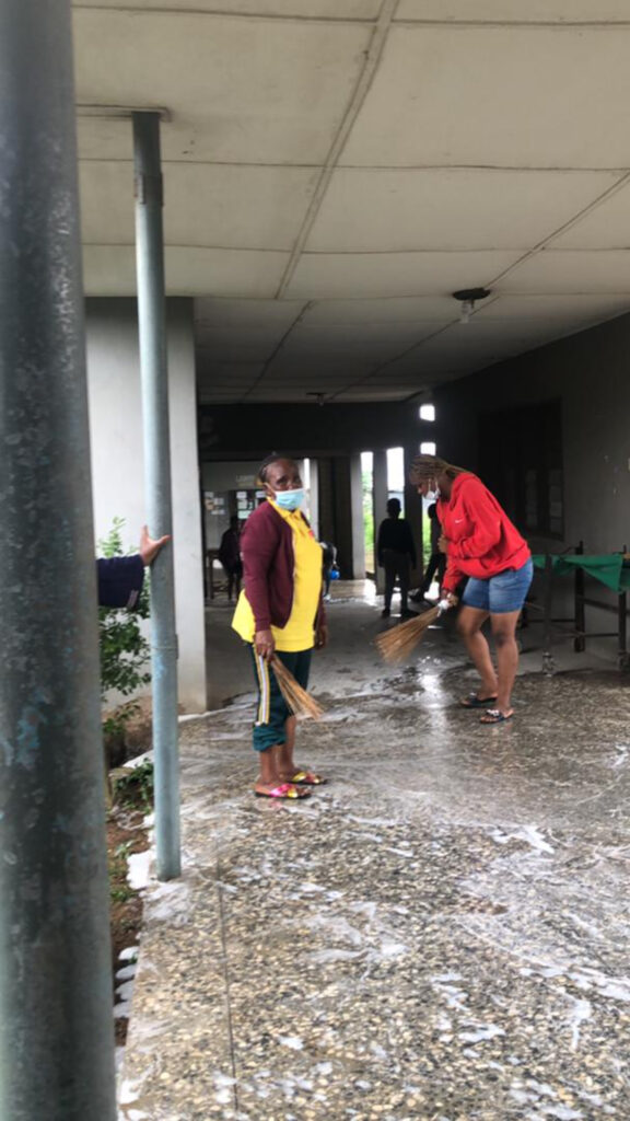 Ibadan Nigeria Stake members help to keep the Ibadan General Hospital clean during the 2021 All Africa Service Day activities on Aug. 21, 2021.