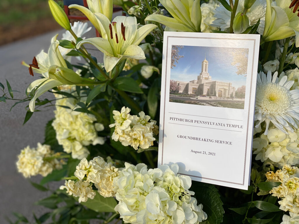 A copy of the program at the Pittsburgh Pennsylvania Temple groundbreaking ceremony can be seen on a bouquet of flowers on Aug. 21, 2021.