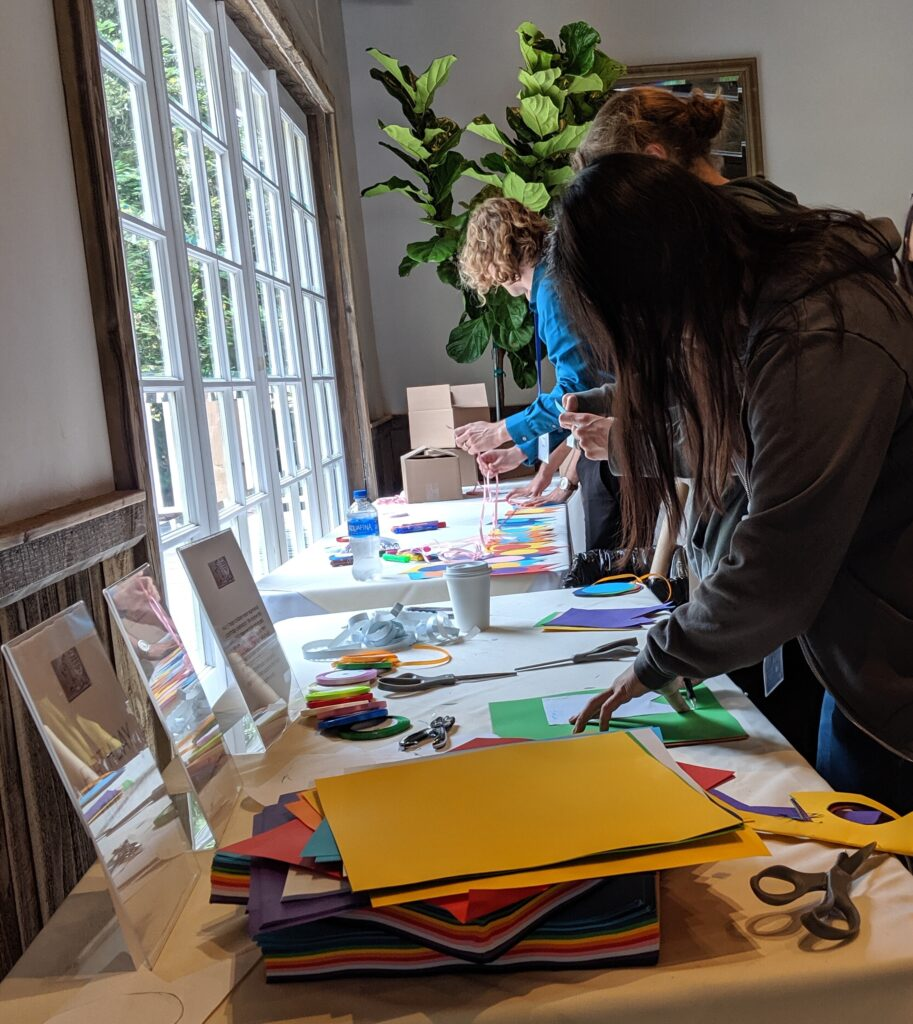 Google employees craft birthday banners in 2019 as part of a JustServe project assisting foster children in Southern California.