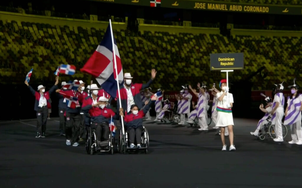 Swimmer Lourdes Alejandra Aybar, seated right, was one of the flag bearers for her Dominican Republic during the opening ceremony for the 2020 Paralympics at the National Stadium in Tokyo, Tuesday, Aug. 24, 2021.
