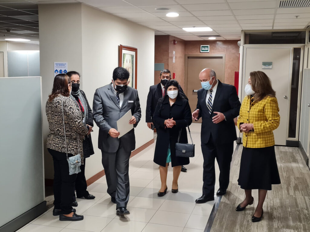 Peru's first lady, Lilia Paredes, discusses Latter-day Saint humanitarian efforts during a visit to the Church's area office in Lima with Elder Jorge F. Zeballos, a General Authority Seventy and president of the area, who was accompanied by his wife, Sister Carmen Gloria Zeballos, August 2021.