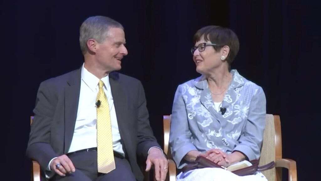 Elder David A. Bednar of the Quorum of the Twelve Apostles and his wife, Sister Susan Bednar, address single adults on Friday, Aug. 6, 2021, from Oakland, California.