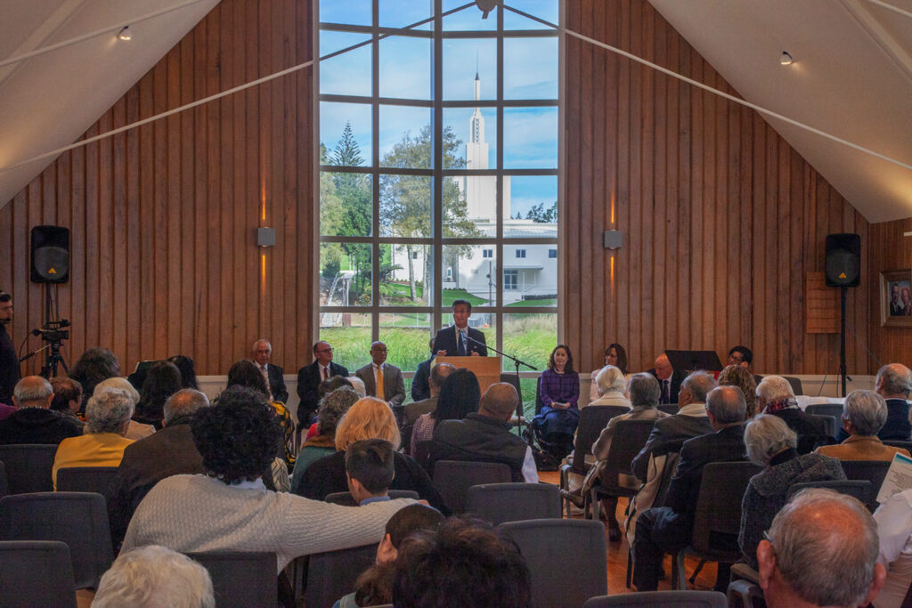 Elder Kazuhiko Yamashita, a General Authority Seventy, speaks in the George R. Biesinger Hall adjacent to the Hamilton New Zealand Temple during the opening of a new exhibit on labor missionaries at the Matthew Cowley Church History Center in Temple View, New Zealand.