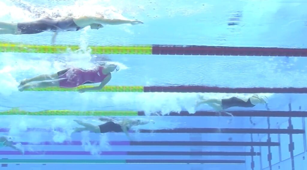 New Zealand's Tupou Neiufi, back, swims in the 50-meter freestyle S8 heats at the Tokyo Aquatics Centre at the Tokyo 2020 Paralympic Games in Tokyo, Wednesday, Sept. 2, 2021.
