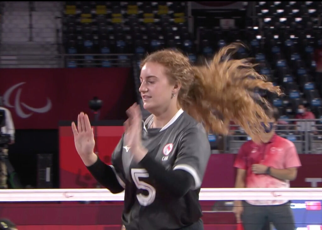 Canada's Payden Vair (5) waves as she joins her team on the court during the women's sitting volleyball semifinal match against China in at the Tokyo 2020 Paralympic Games, Friday, Sept. 3, 2021, in Chiba, east of Tokyo, Japan.