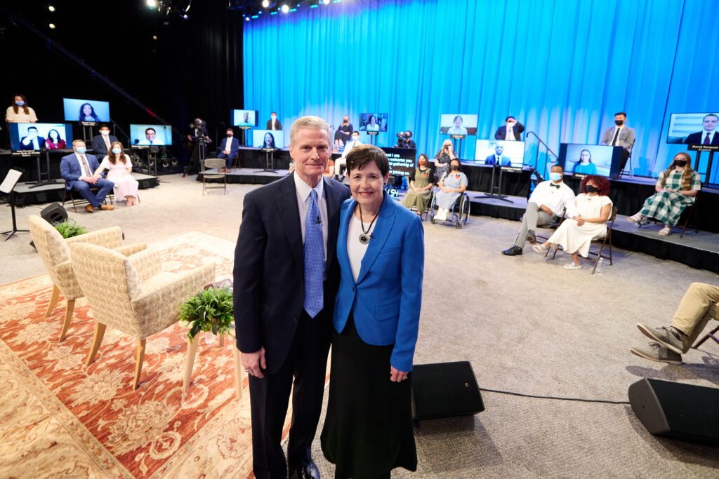 Elder David A. Bednar of the Quorum of the Twelve Apostles and his wife, Sister Susan Bednar, pose with the small studio audience in the Conference Center Theater in Salt Lake City, for a Face to Face event broadcast on Sunday, Sept. 12, 2021.