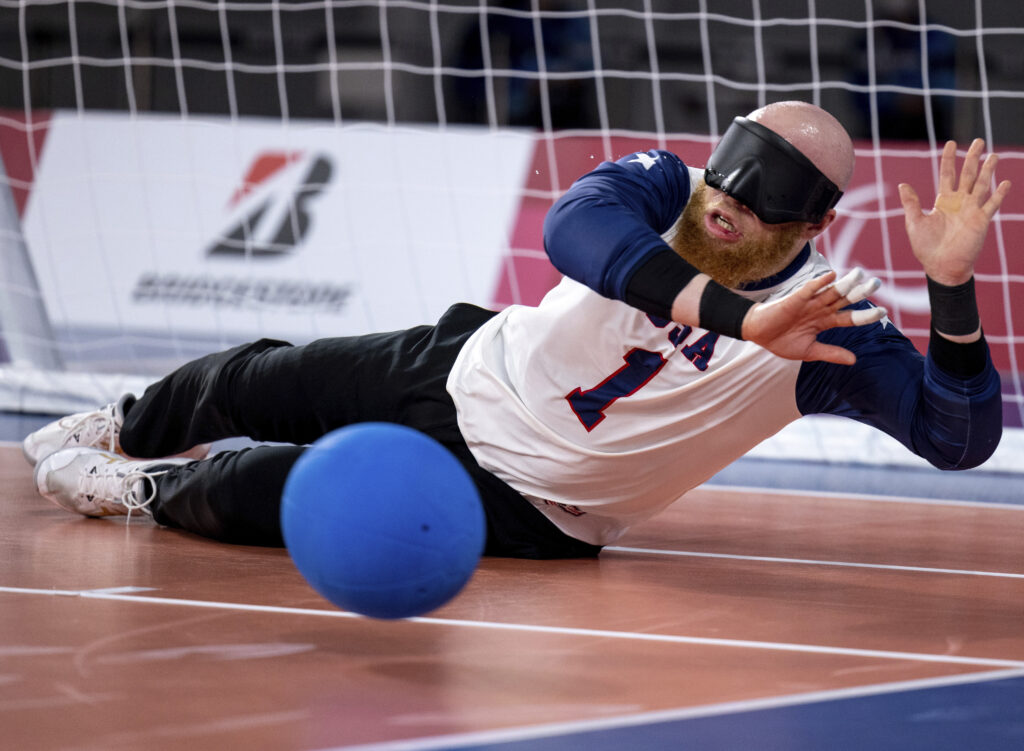 USA's Daryl Walker dives to save the ball during the Men's Goalball Bronze Medal match between United States and Lithuania during the Tokyo 2020 Paralympic Games, Chiba, Japan, Friday Sept. 3, 2021.