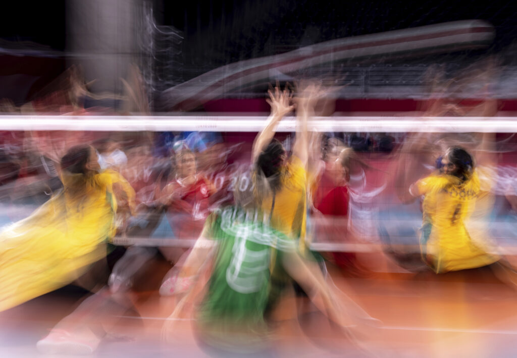 Motion blur image taken during the women's bronze medal sitting volleyball match between Brazil and Canada during the Tokyo 2020 Paralympic Games in Chiba, Japan, Saturday, Sept. 4, 2021.