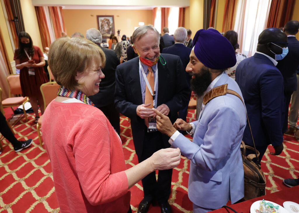 Sister Sharon Eubank, first counselor in the Relief Society general presidency, chats with David Pollei of the G20IF Advisory Council, and Khushwant Singh prior to speaking about world hunger during the G20 Interfaith Forum in Bologna, Italy on Tuesday, Sept. 14, 2021.
