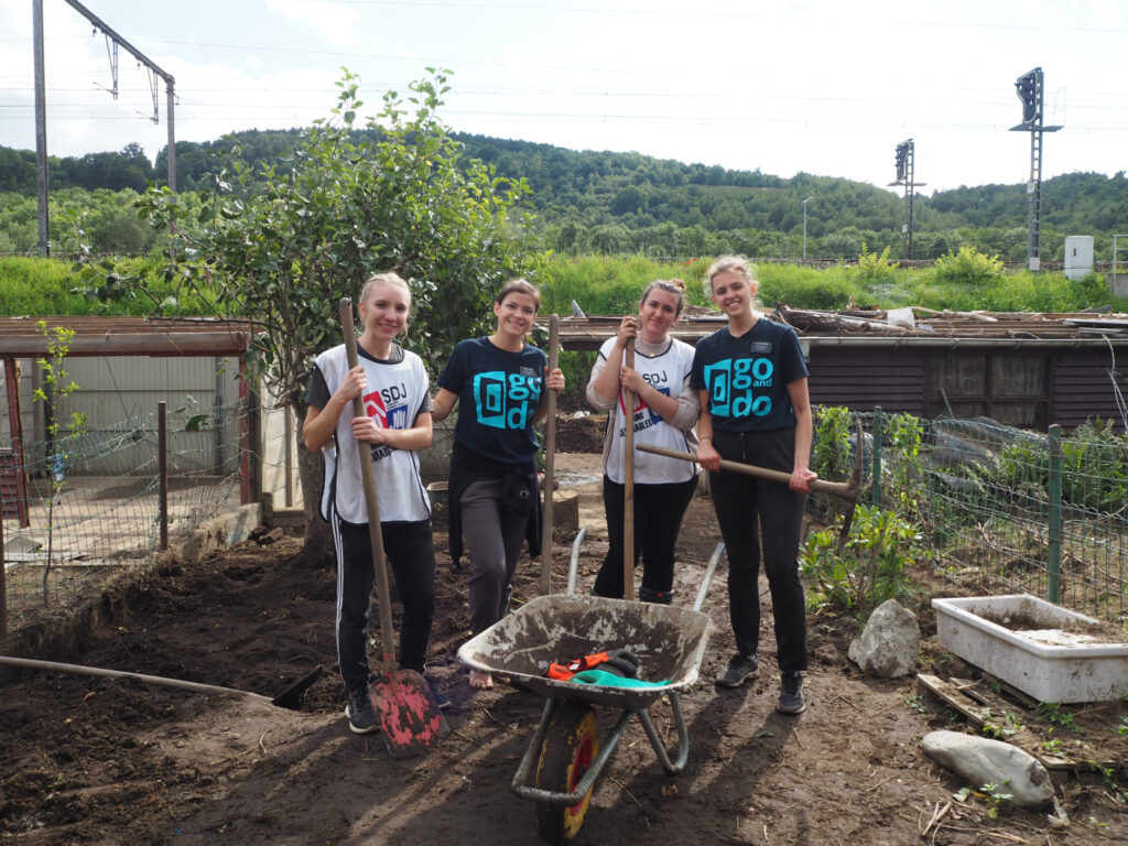 A group of sister missionaries Martine Durtka clean up her back yard in Belgium in August 2021 after floods devastated the area.